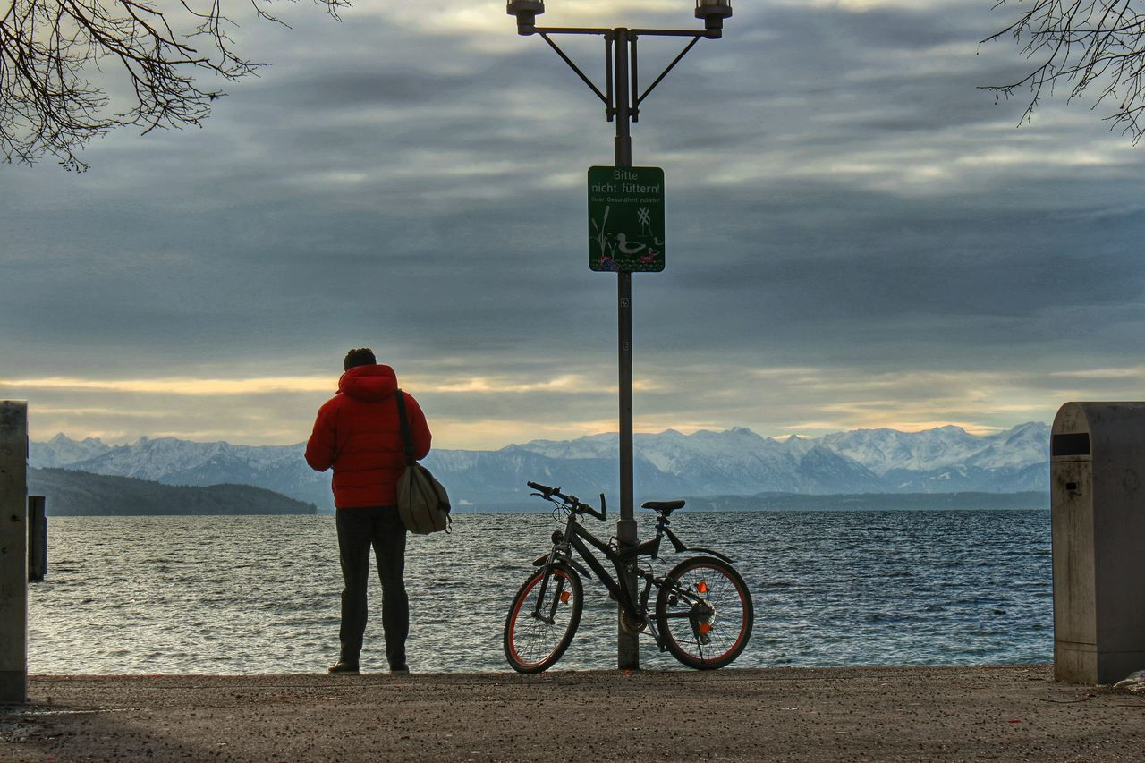 cloud - sky, sky, transportation, full length, water, scenics, nature, bicycle, tranquil scene, communication, sea, real people, mountain, day, one person, beauty in nature, lifestyles, outdoors, men, people