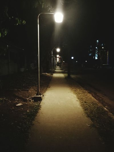 walking alone Night Illuminated Street Light Lighting Equipment No People Outdoors Tree Nature Sky Alone Night Life Quiet Quiet Night Lonely Road Road At Night Light