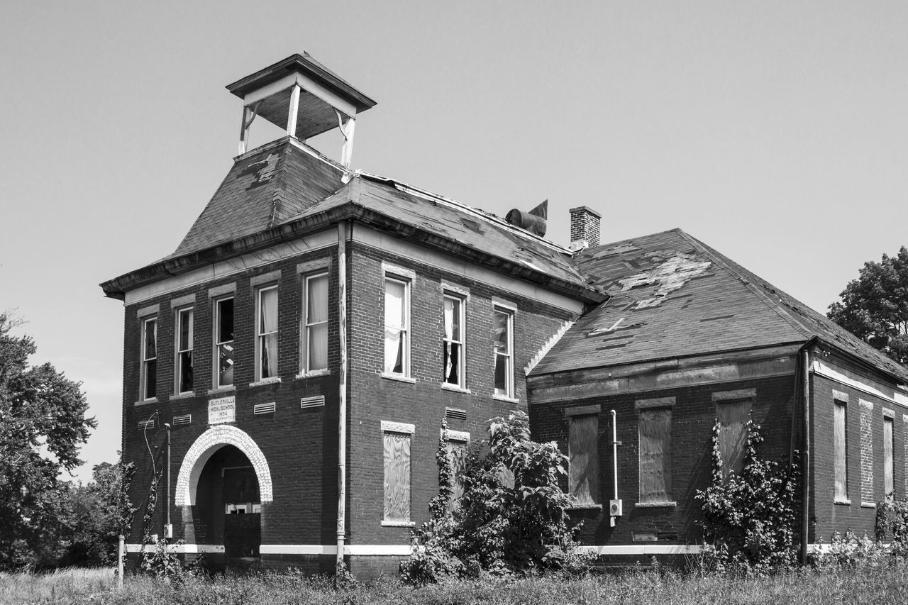 Decaying school building. Architecture Belfry Black And White Building Exterior Built Structure Closed Day Decayed Low Angle View No People Old School Outdoors Rural Rural Decay Rural School School Sky