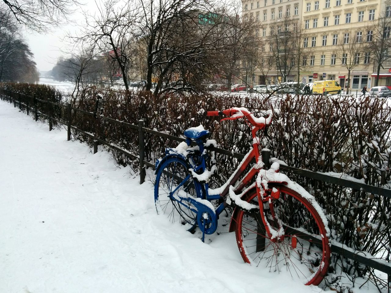 Bicycle Parked On Snowcapped Footpath During Winter