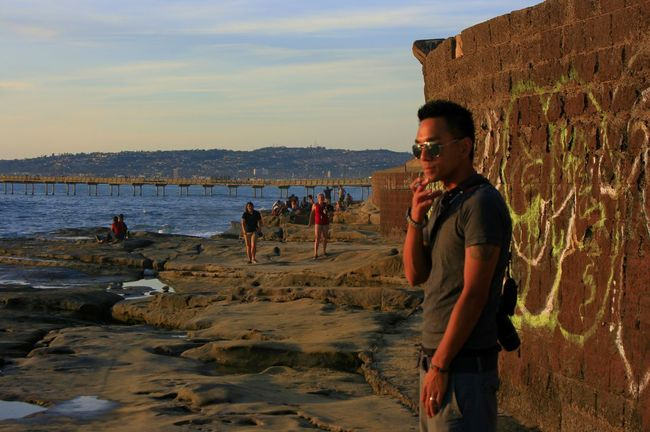 Hanging at ocean beach San diego on April 20 2016 Chasing Sunsets with me my wife and my camera enjoying the Amazing view and count how many times the waves would splash on us. Ocean Beach Unforgettable Sunsets Sitting On A Rock Chasing Sunsets Chasing Sunsets Me My Wife And My Camera Ocean Beach San Diego Unforgettable Beauty Orange Sky Counting Waves Colorful Sunset April 20 2016 Amazing View Ocean Beach Pier Blue Wave Happy 420 Cool Guy The Portraitist - 2016 EyeEm Awards Feel The Journey