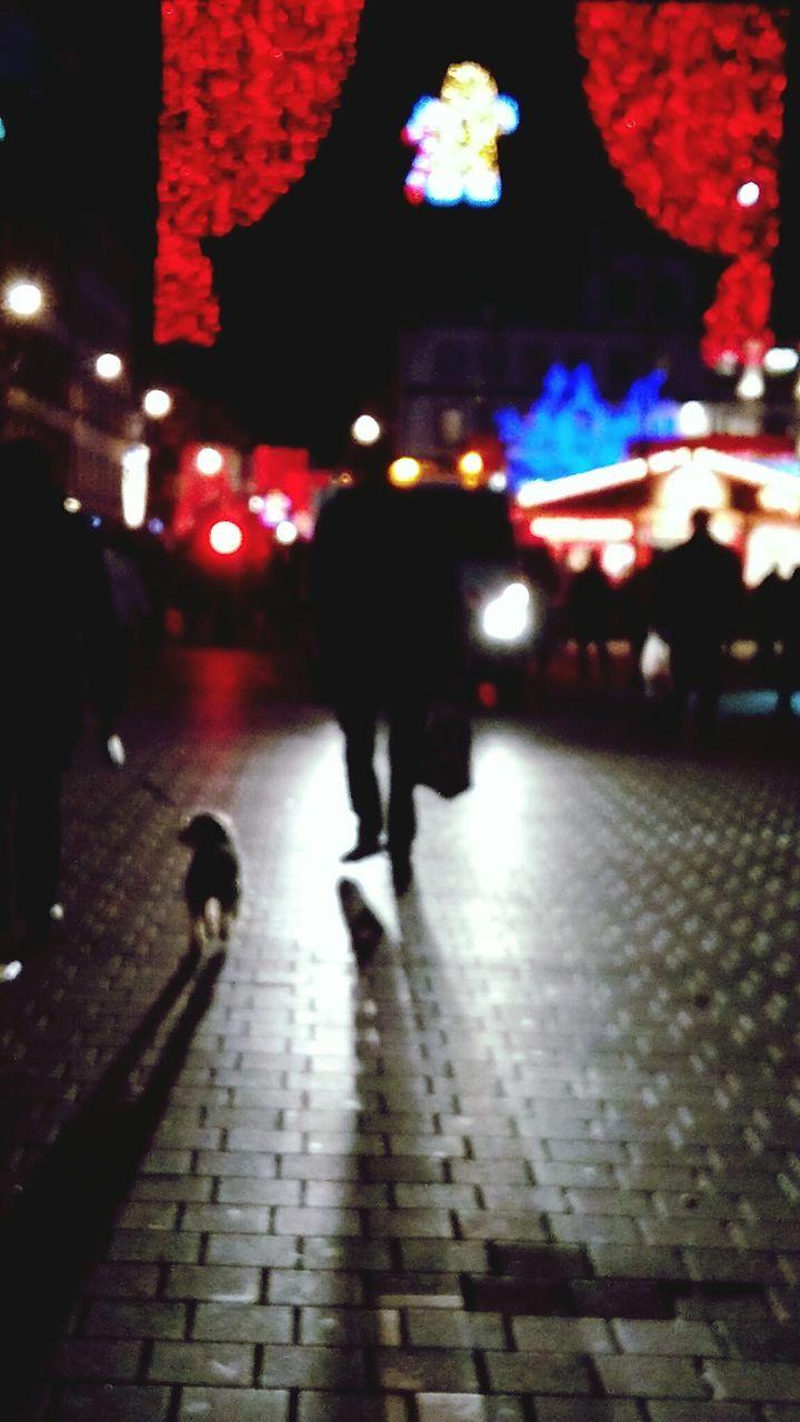 illuminated, walking, night, real people, rear view, street, full length, men, outdoors, lifestyles, city, pedestrian, women, adult, people