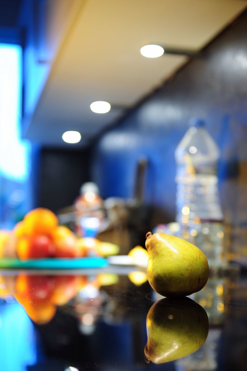 illuminated, fruit, focus on foreground, indoors, food and drink, food, apple - fruit, close-up, yellow, no people, healthy eating, multi colored, freshness, day
