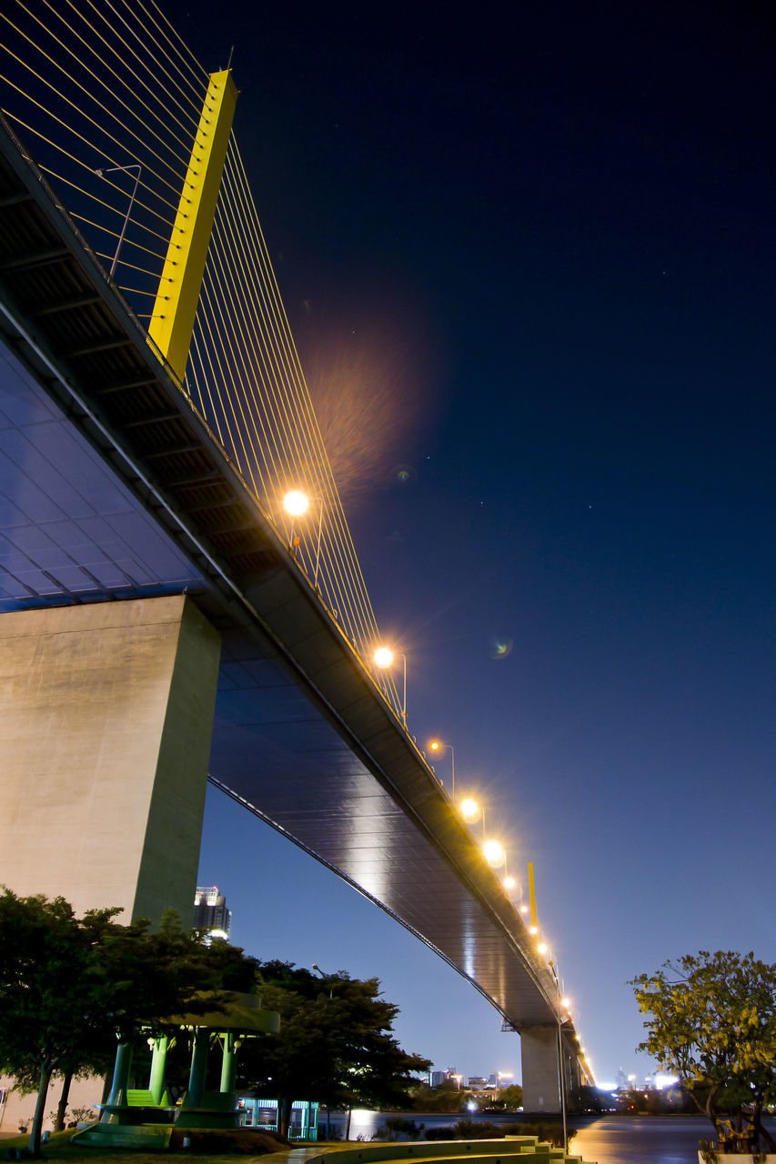 illuminated, night, built structure, architecture, low angle view, outdoors, no people, sky, street light, bridge - man made structure, tree, building exterior, clear sky, city, nature