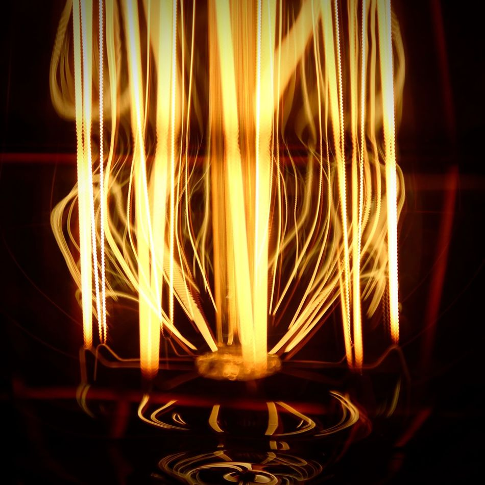 Edison lightbulb Black Background Burning Burning Close-up Electricity  EyeEm Diversity Filament Flame Glowing Heat - Temperature Illuminated Indoors  Lamp Light Bulb Long Exposure Motion Night No People Pattern The Secret Spaces Wire Wool Yellow