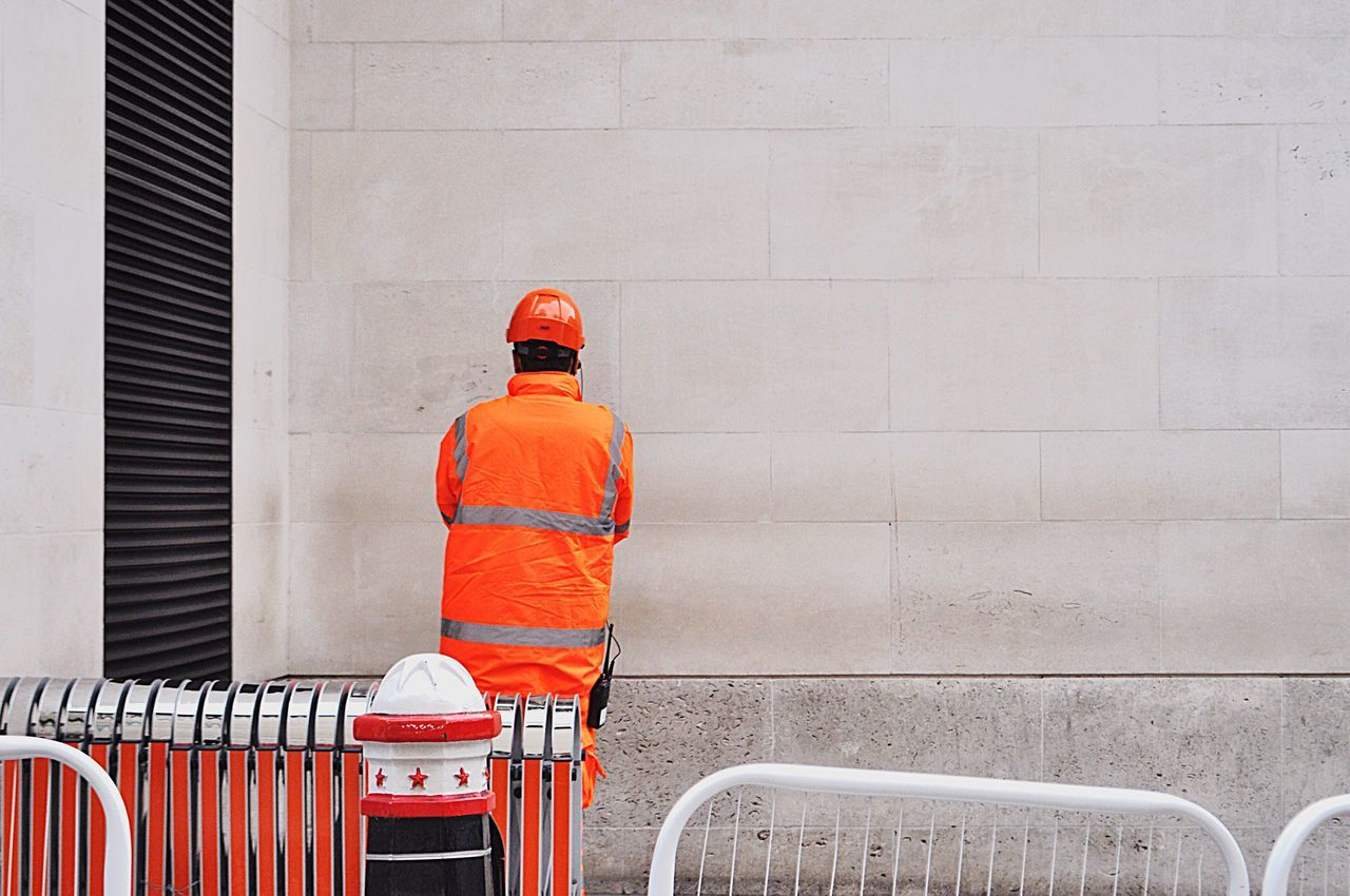 London Lifestyle London Orange Color Uniform Outdoors Work Worker Street Photography Streetphotography People Rear View City Life