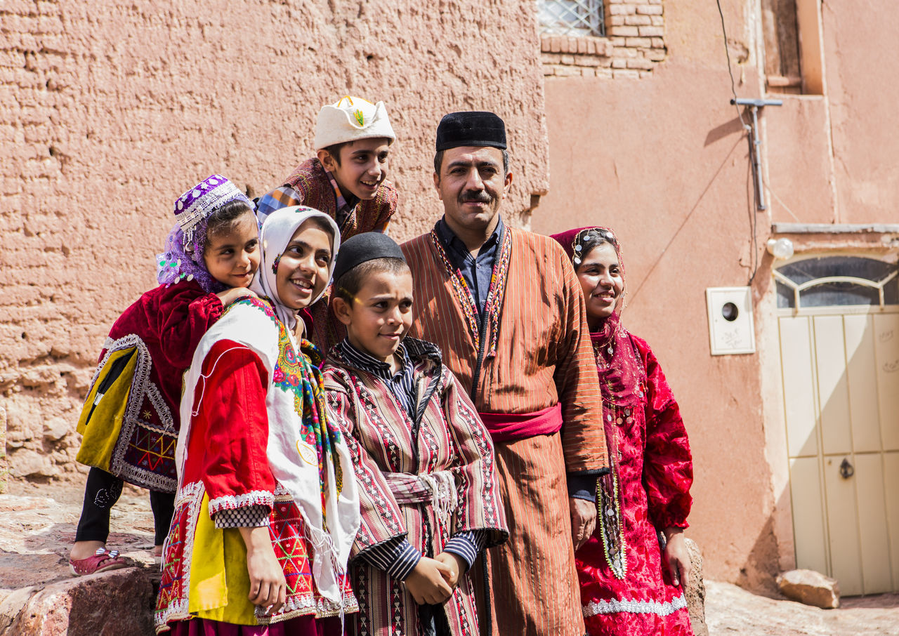 they are family Members with traditional dress in alley of Abyaneh village, Kashan.City Abyaneh Clothes Dress Happiness Iran Iranian Iranian People Outdoors People Portrait Real People Smiling The Great Outdoors - 2017 EyeEm Awards The Photojournalist - 2017 EyeEm Awards The Portraitist - 2017 EyeEm Awards Traditional Clothing Traditional Costume BYOPaper! Place Of Heart