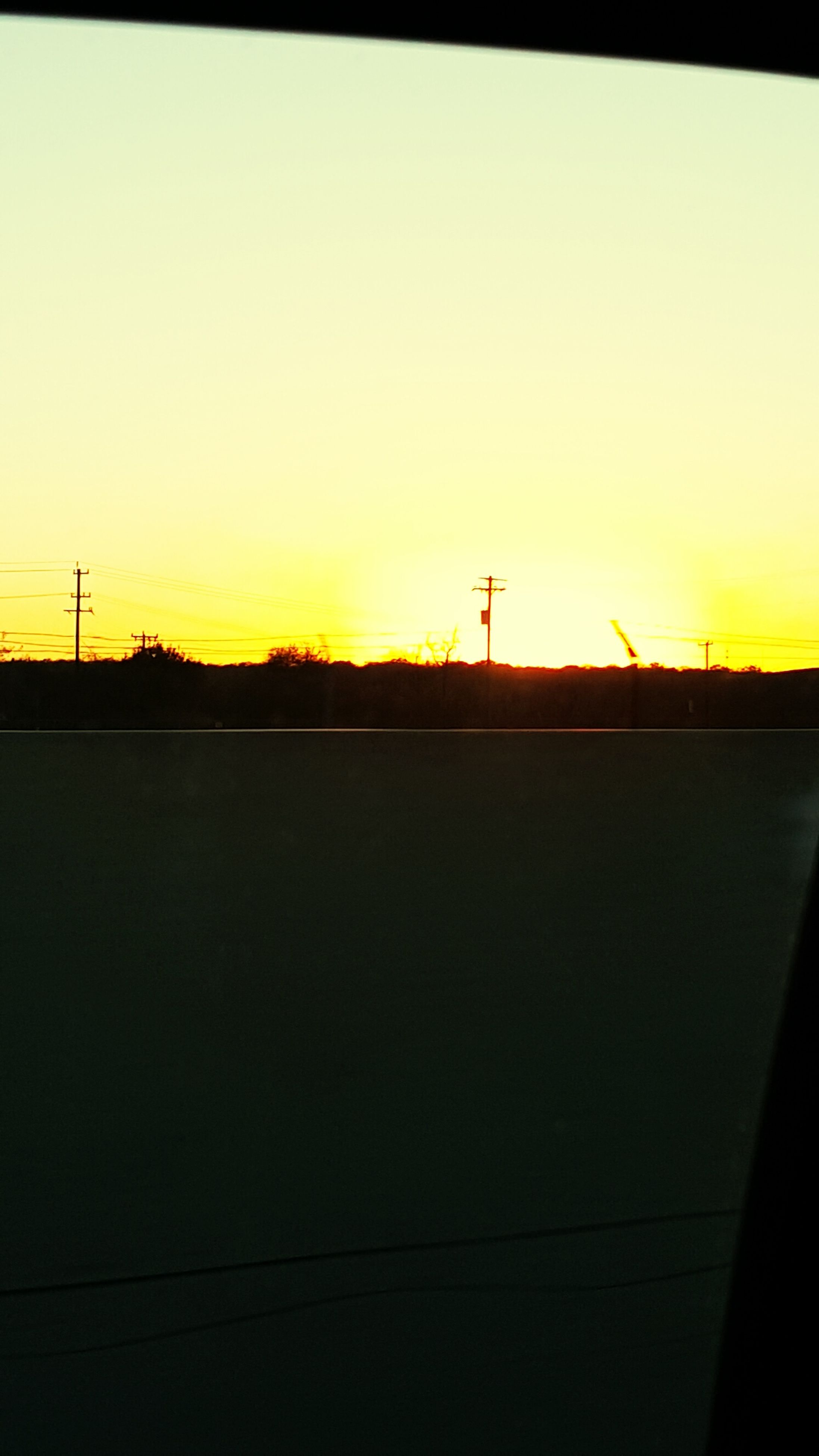 sunset, silhouette, orange color, copy space, clear sky, electricity pylon, fuel and power generation, electricity, power line, technology, connection, power supply, sky, beauty in nature, dark, scenics, tranquility, tranquil scene, nature, landscape