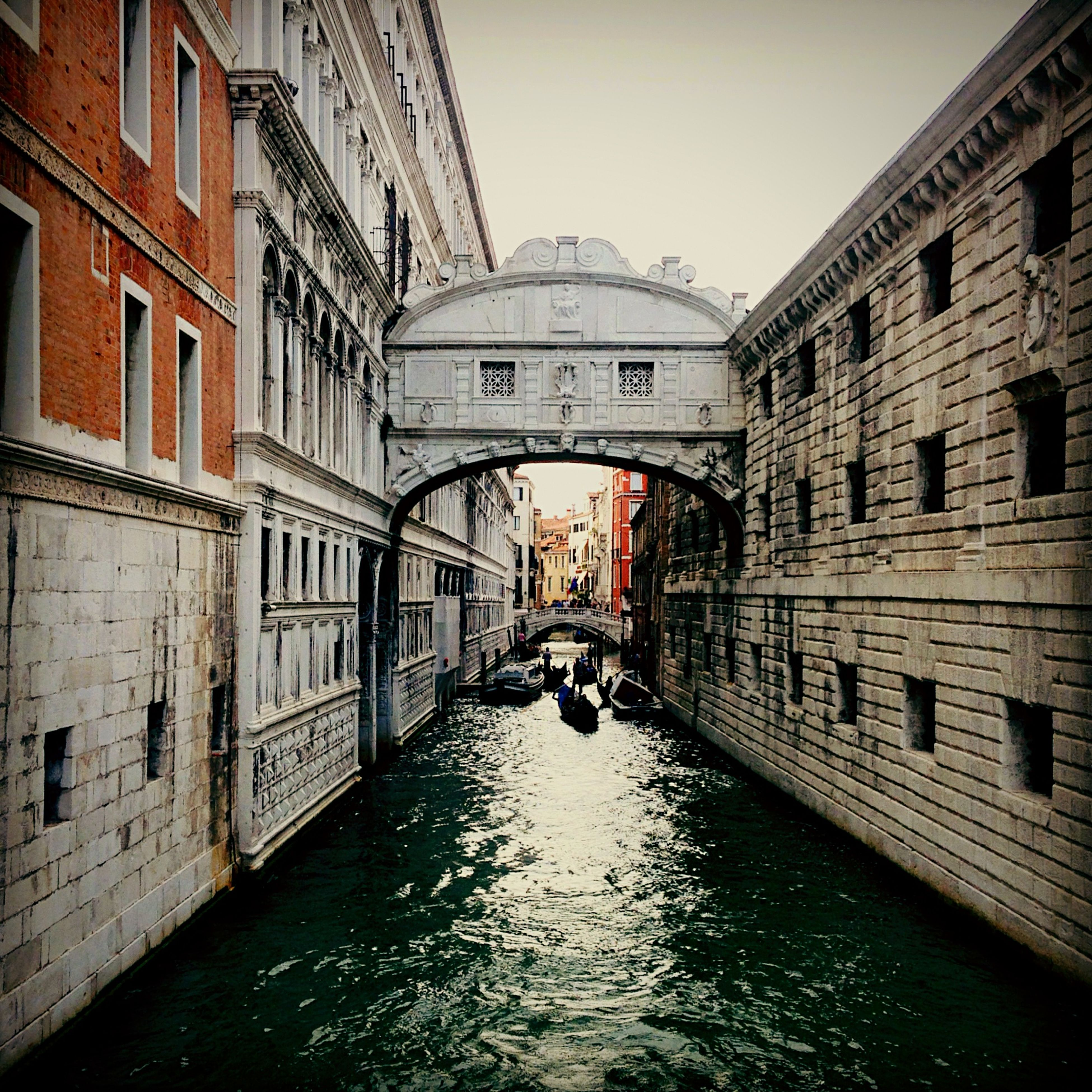 architecture, built structure, building exterior, water, canal, waterfront, building, diminishing perspective, residential building, residential structure, reflection, city, river, the way forward, day, rippled, arch, narrow, transportation, old town