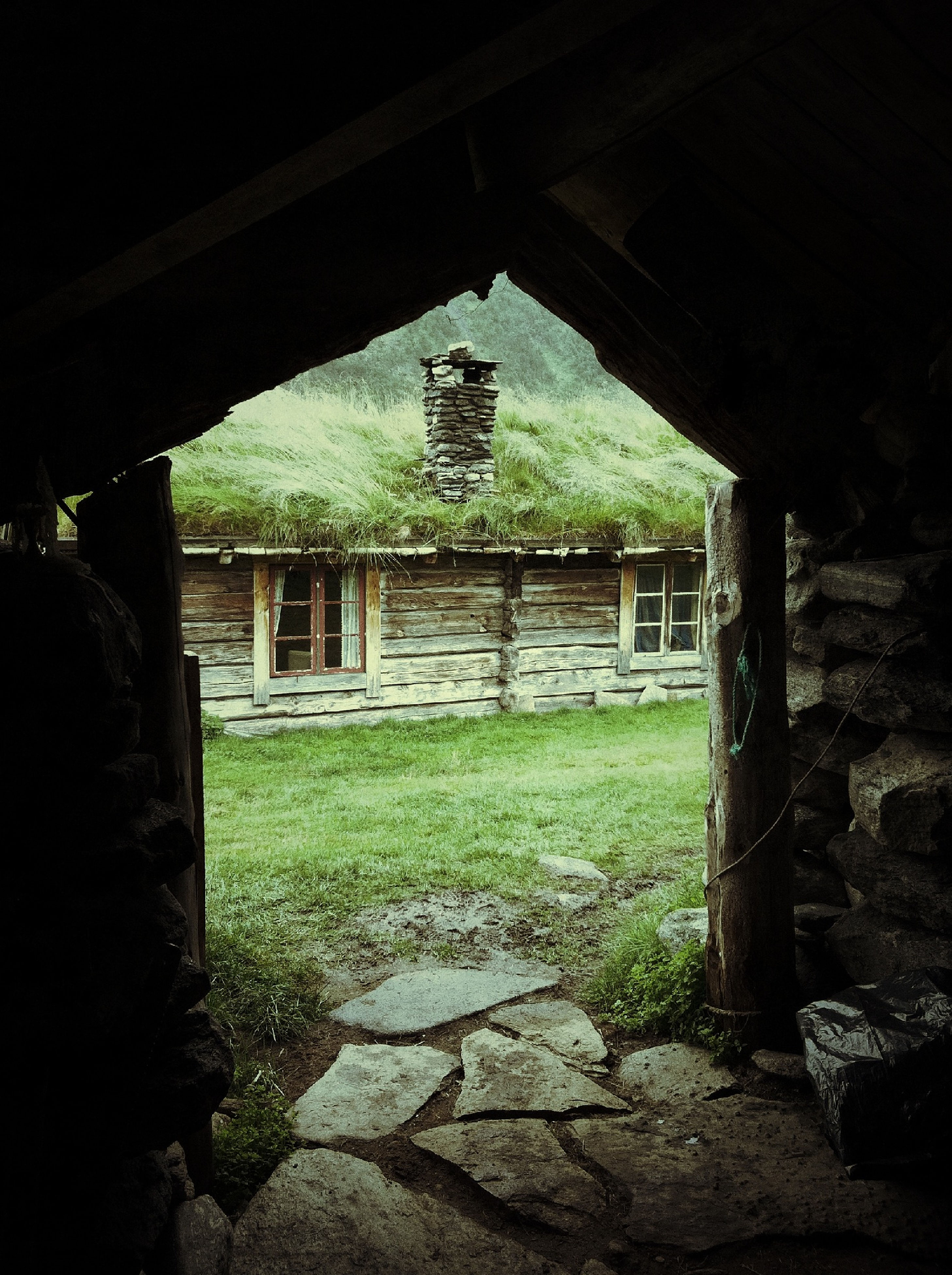 architecture, built structure, old ruin, history, abandoned, old, building exterior, grass, stone wall, obsolete, damaged, the past, indoors, ruined, run-down, stone material, tree, deterioration, ancient, arch