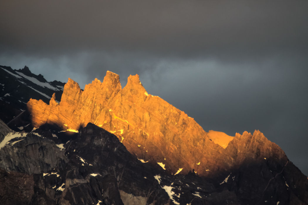 Sunset on the Cuernos del Paine. The Cuernos or Horns are dark bands of heavily eroded sedimentary stratum that contrast strongly with the lighter exposed granite below. Torres del Paine National Park, Patagonia, Chile. Love Life, Love Photography Alpenglow Alpine Beauty In Nature Chile Del Granite Light Mountain National Nature No People Outdoors Park Patagonia Ridge Road Rock - Object Scenics Sedimentary Sky Stratum Sunset Torres Torres Del Paine Mountains, Tranquility