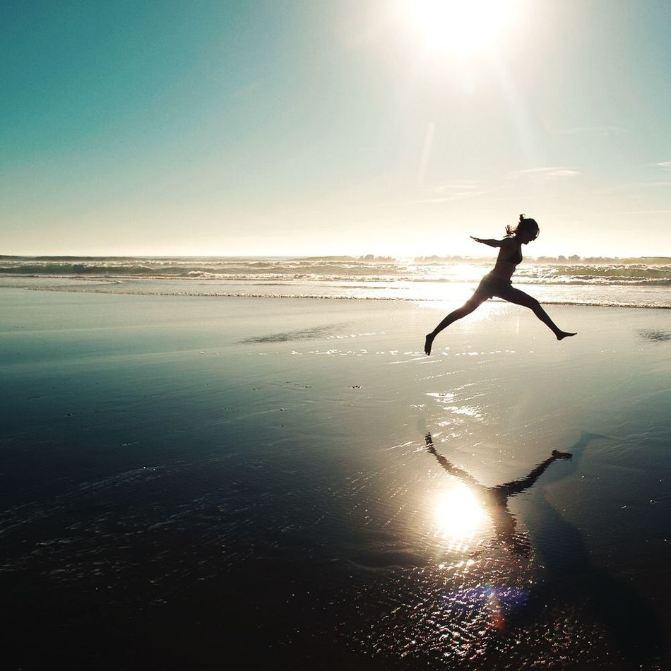 Beautiful stock photos of jump, Activity, Arms Outstretched, Beach, City Life