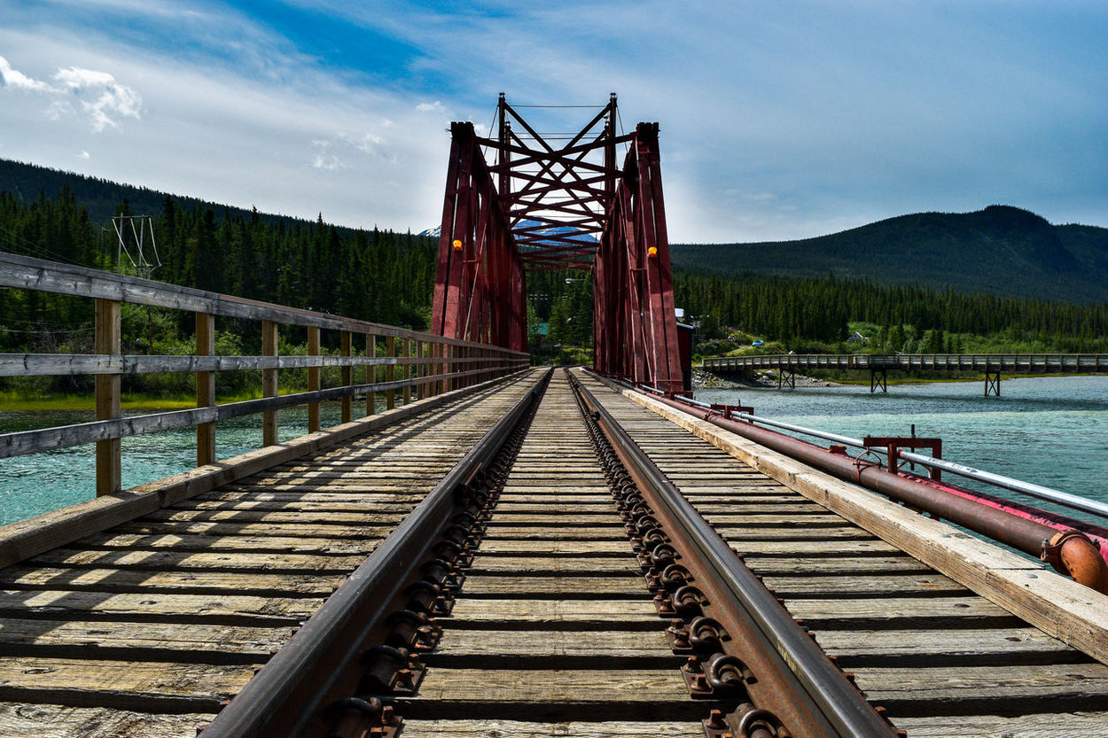 Architecture Blane Arnold Photography Bridge - Man Made Structure Building Exterior Built Structure Canada Carcross Cloud Cloud - Sky Connection Day Diminishing Perspective Footbridge Mountain Pier Railing Railroad Track River Sky The Way Forward Transportation Vanishing Point Water Yukon Bay