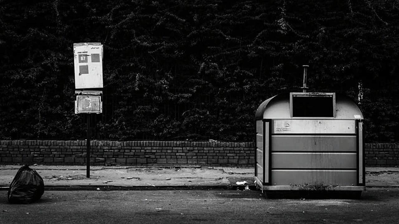 The Street Photographer - 2015 EyeEm Awards Streetphotography Urbanphotography Bus Rubbish Bin Rubbish Bag Ecology City Life Nikon D7000 Black & White