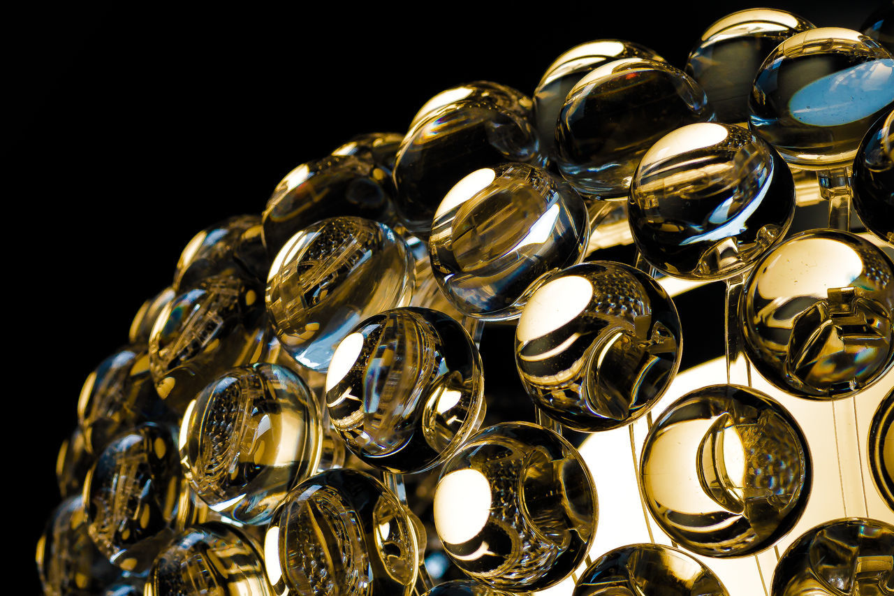 gold colored, large group of objects, shiny, no people, gold, close-up, black background, day