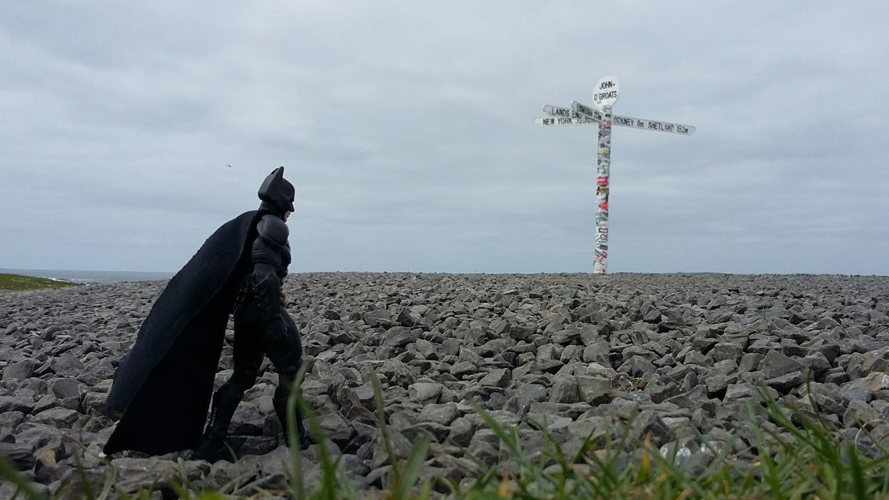 So I caught batman taking a stroll in northern Scotland 😀 Sky Day Outdoors Signpost Sign Famous Place John O'Groats Scotland North Coast Clouds And Sky Cloudy Batman