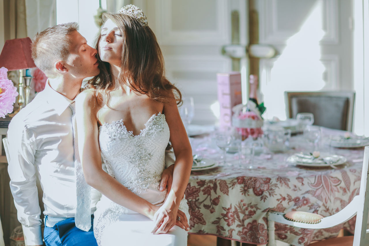 Bride And Groom Couple France French Indoors  Interior Just Married Kissing Love Lovers Luxury Paris Summer Sunlight Table Tender Tiara Wedding Wedding Day Wedding Photography