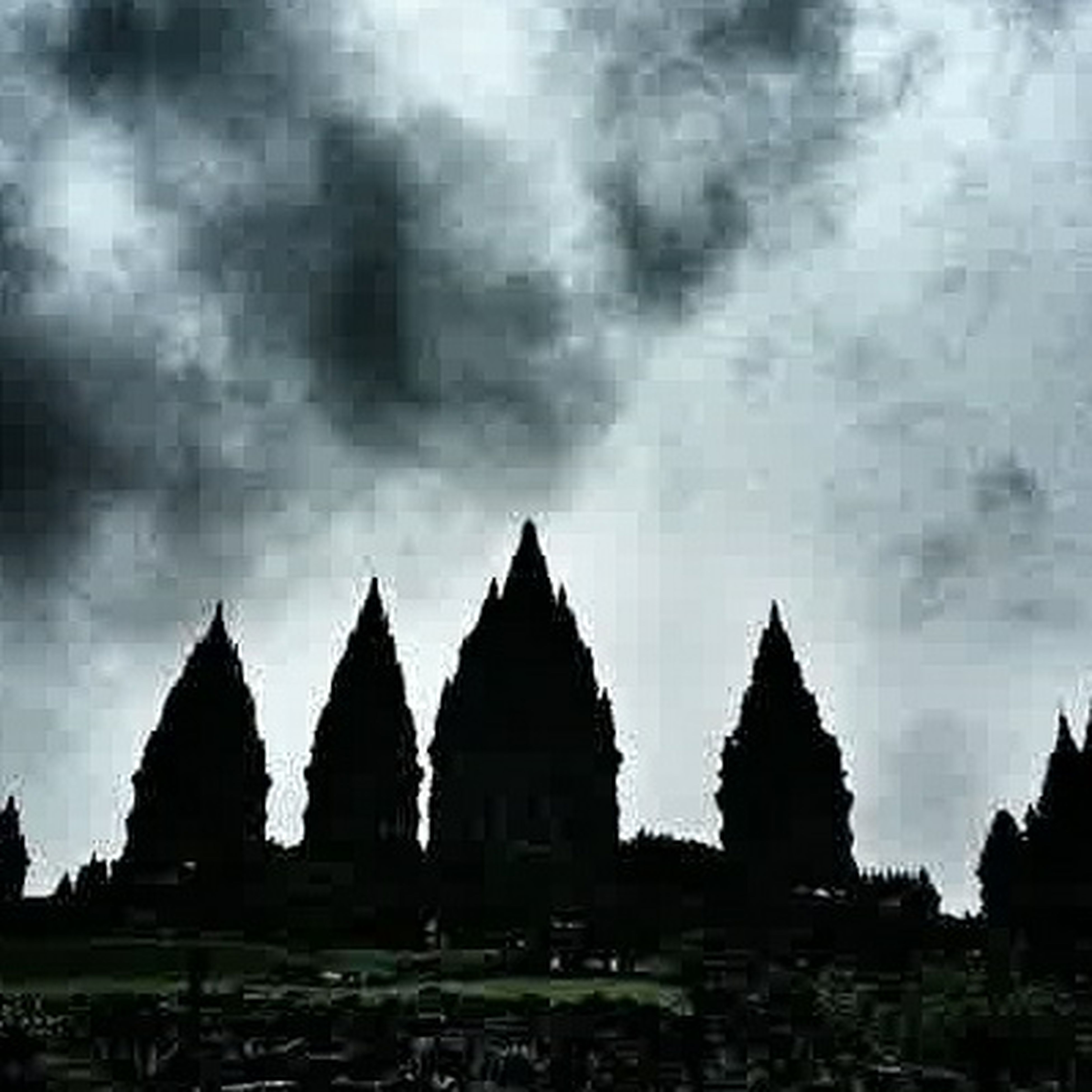 sky, place of worship, religion, spirituality, built structure, architecture, cloud - sky, temple - building, silhouette, cloudy, weather, dusk, building exterior, history, outdoors, tranquility, in a row, travel destinations, nature, travel