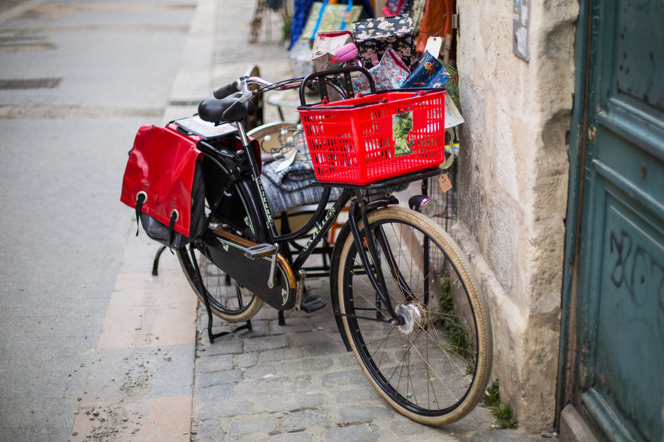 Architecture Basket Bicycle Built Structure City Cycle Day Land Vehicle Mode Of Transport Parking Pole Red Road Stationary Street Transportation Travel