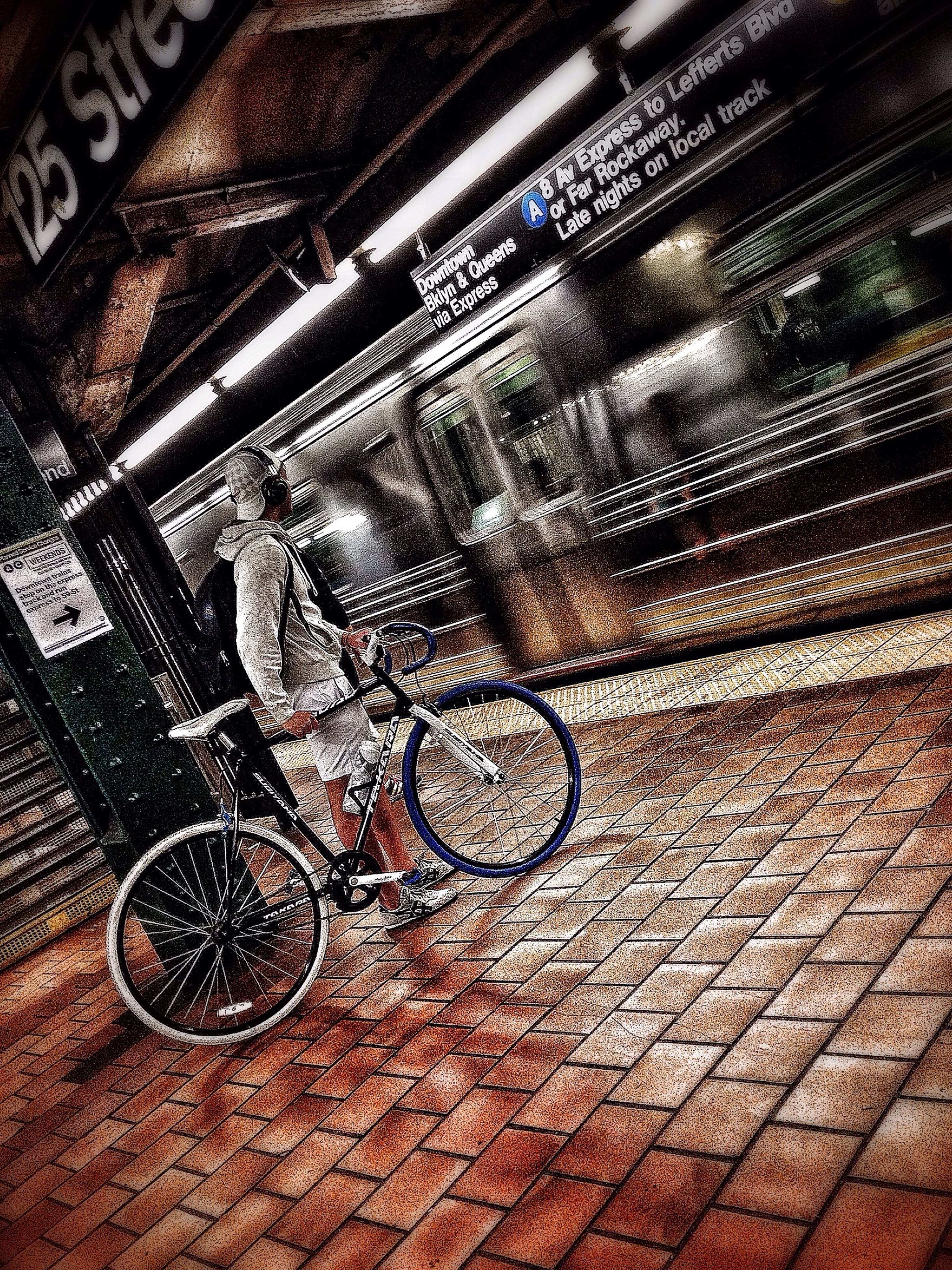 transportation, mode of transport, land vehicle, bicycle, stationary, parking, parked, street, travel, indoors, car, no people, high angle view, illuminated, night, wheel, sidewalk, architecture, old-fashioned