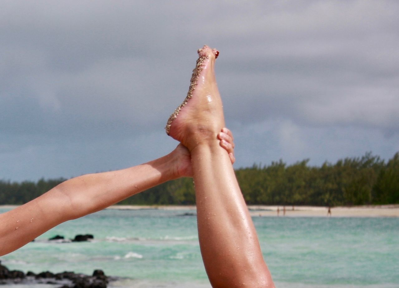 Yoga pose at paradise beach Human Hand Sky Nature Leisure Activity Holding Lifestyles Sea Outdoors Close-up Human Body Part Water Light Beach Summer Relaxation Nature Woman Legs Yoga Yoga Pose Fashion Colors Life Barefoot Sand