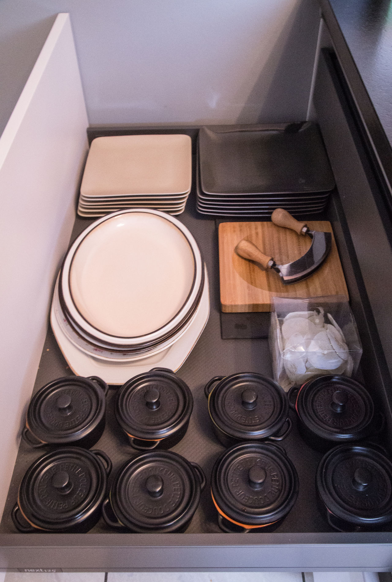 Arrangement Directly Above Everything In Its Place Kitchen Units Kitchenware Large Group Of Objects Plates And Bowls Pull Out Kitchen Drawer Tidy Drawer