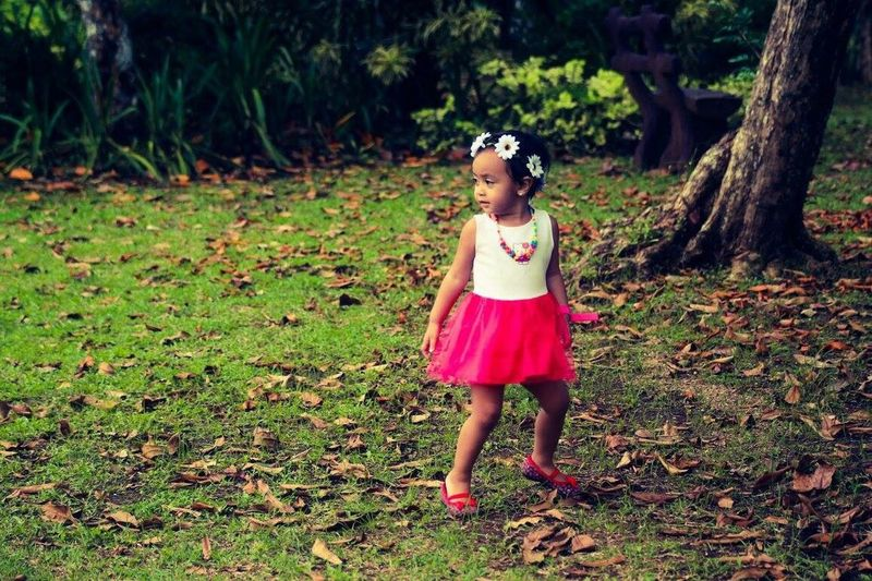 EyeEmNewHere Young Adult Day Outdoors Grass Childhood Full Length One Person Grass Children Only Girls One Girl Only Standing Tree Child Nature People Be. Ready. Happiness Nature Fragility