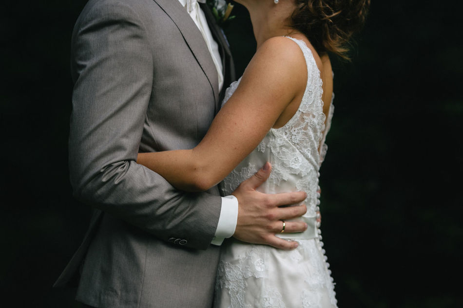 Bride Bride And Groom Close-up Couple Focus On Foreground Groom Holding Just Married Kissing Midsection Suit Wedding Wedding Day Wedding Dress