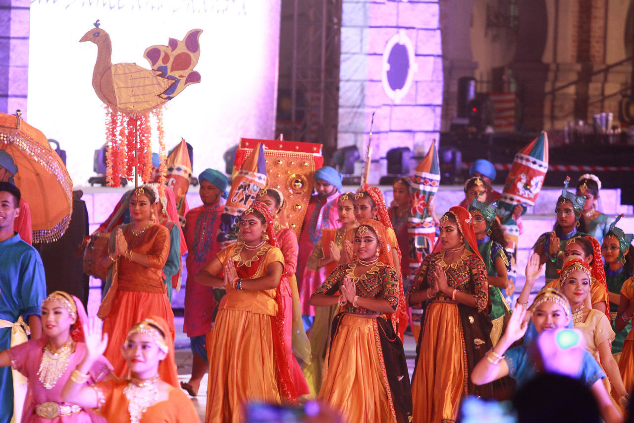 large group of people, celebration, cultures, night, tradition, real people, togetherness, indoors, people