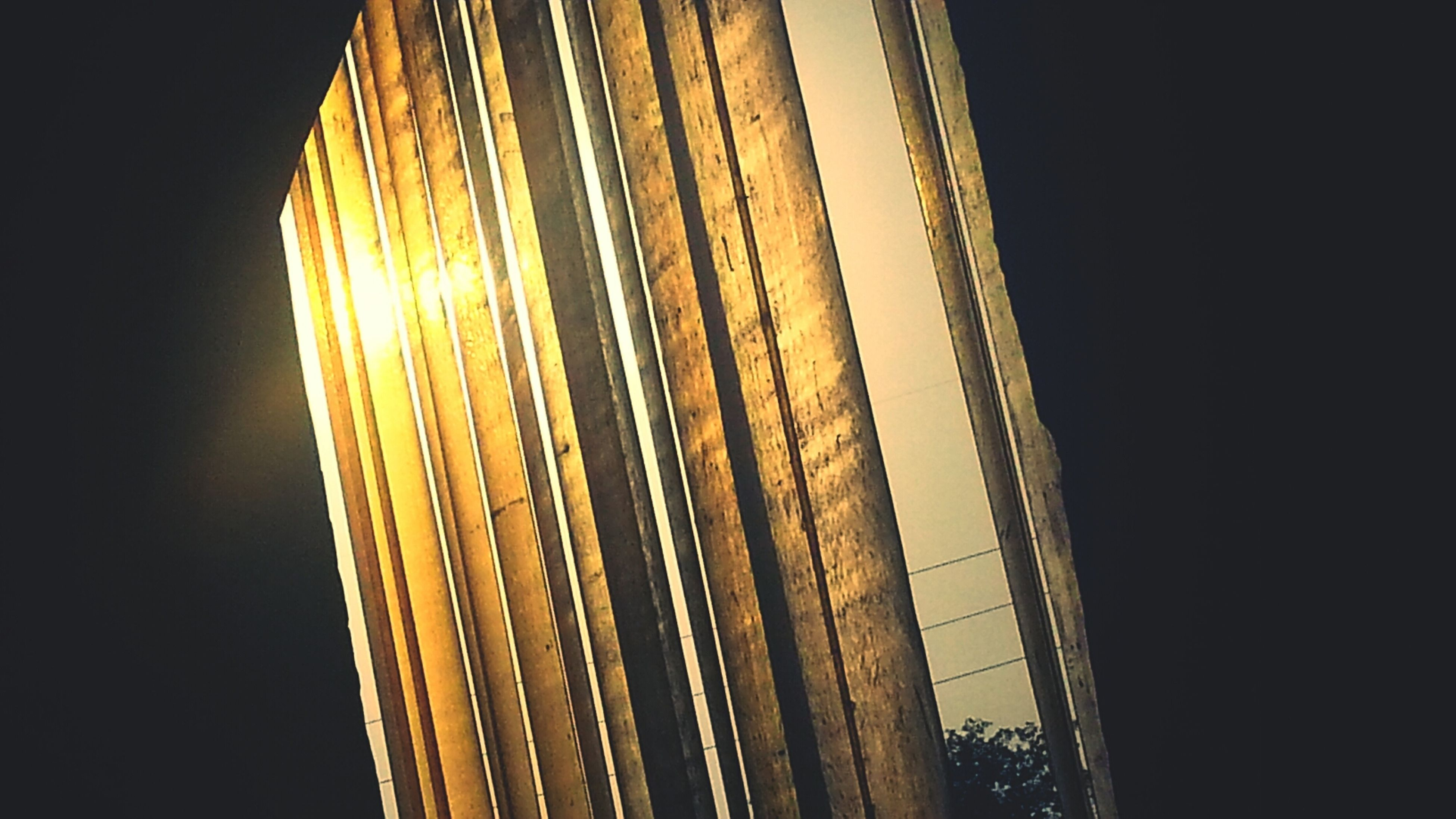 low angle view, built structure, architecture, night, clear sky, illuminated, tall - high, building exterior, modern, city, copy space, sky, tower, skyscraper, outdoors, no people, office building, building, pattern, capital cities