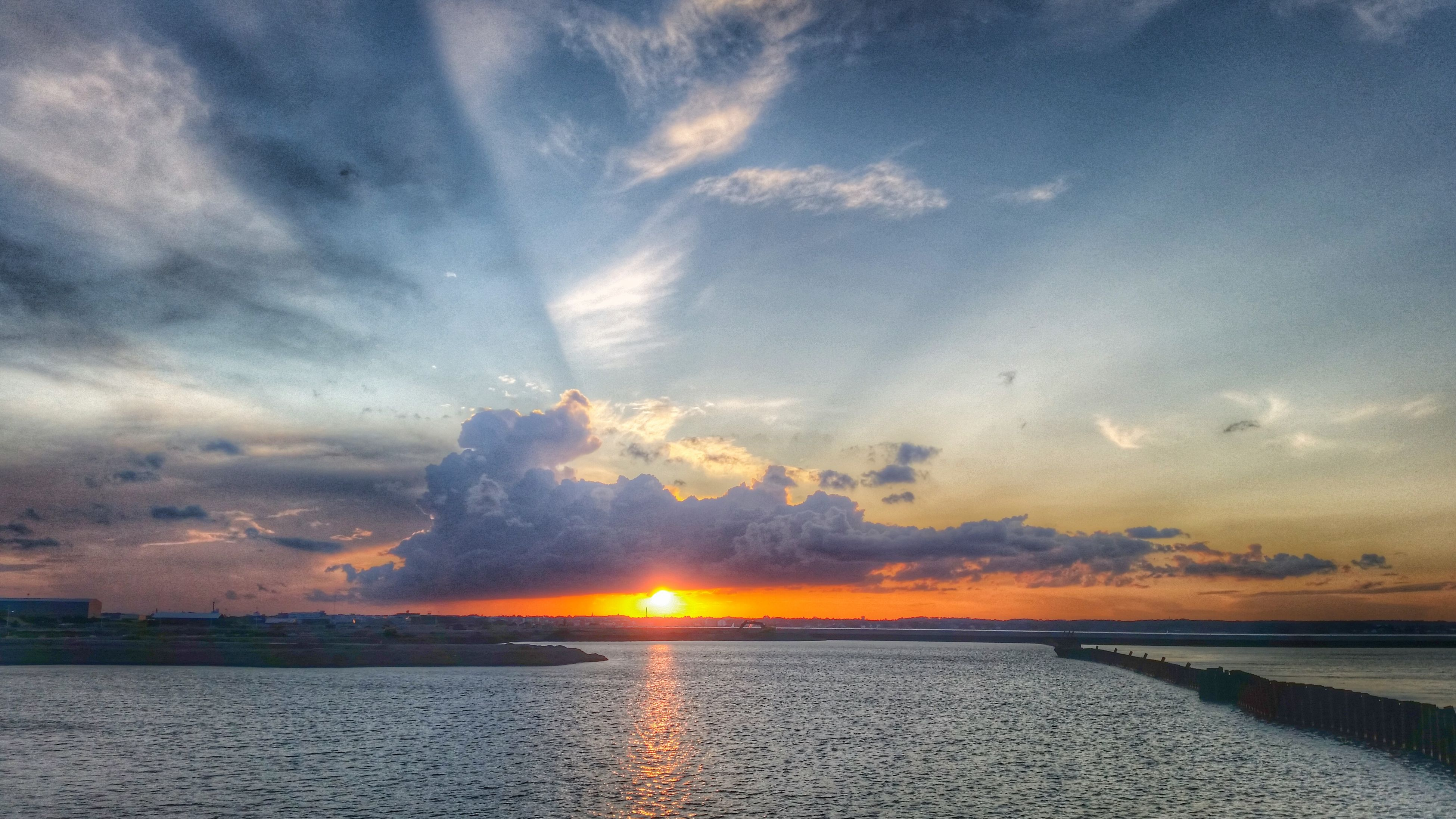 sunset, water, sky, sea, scenics, cloud - sky, beauty in nature, tranquil scene, sun, tranquility, horizon over water, reflection, orange color, nature, idyllic, cloud, sunbeam, sunlight, cloudy, beach