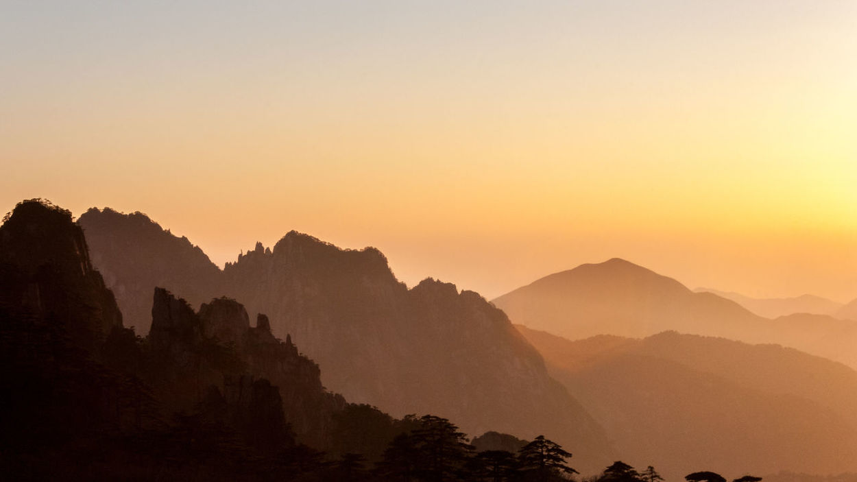 Sunset over yellow mountains in china Yellow Mountains Adventure Beauty In Nature China Clear Sky Height Landscape Mountain Mountain Range Nature No People Outdoors Peak Scenics Sky Sunset Tranquil Scene Tranquility