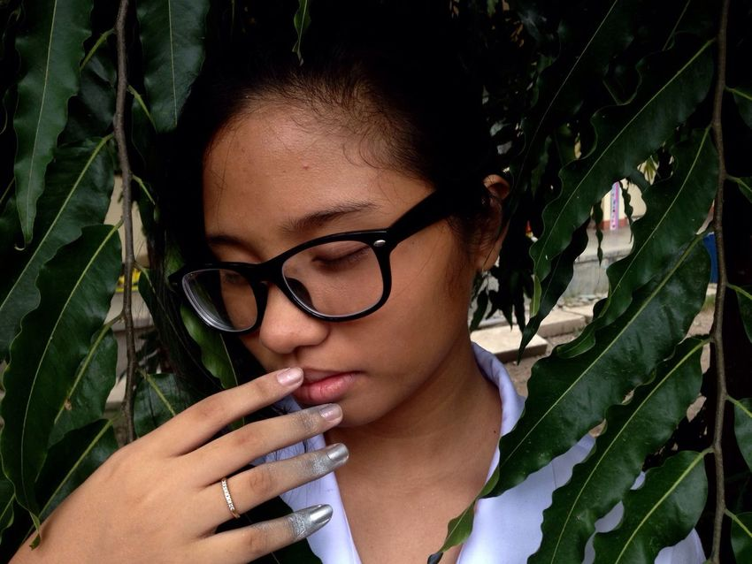 raw photo : i call this Mothernature simply because of the leaves surrounding her, the sadness in her expression and the paint on her hands which represent the pollution, because it is still hard to get rid of. First Eyeem Photo