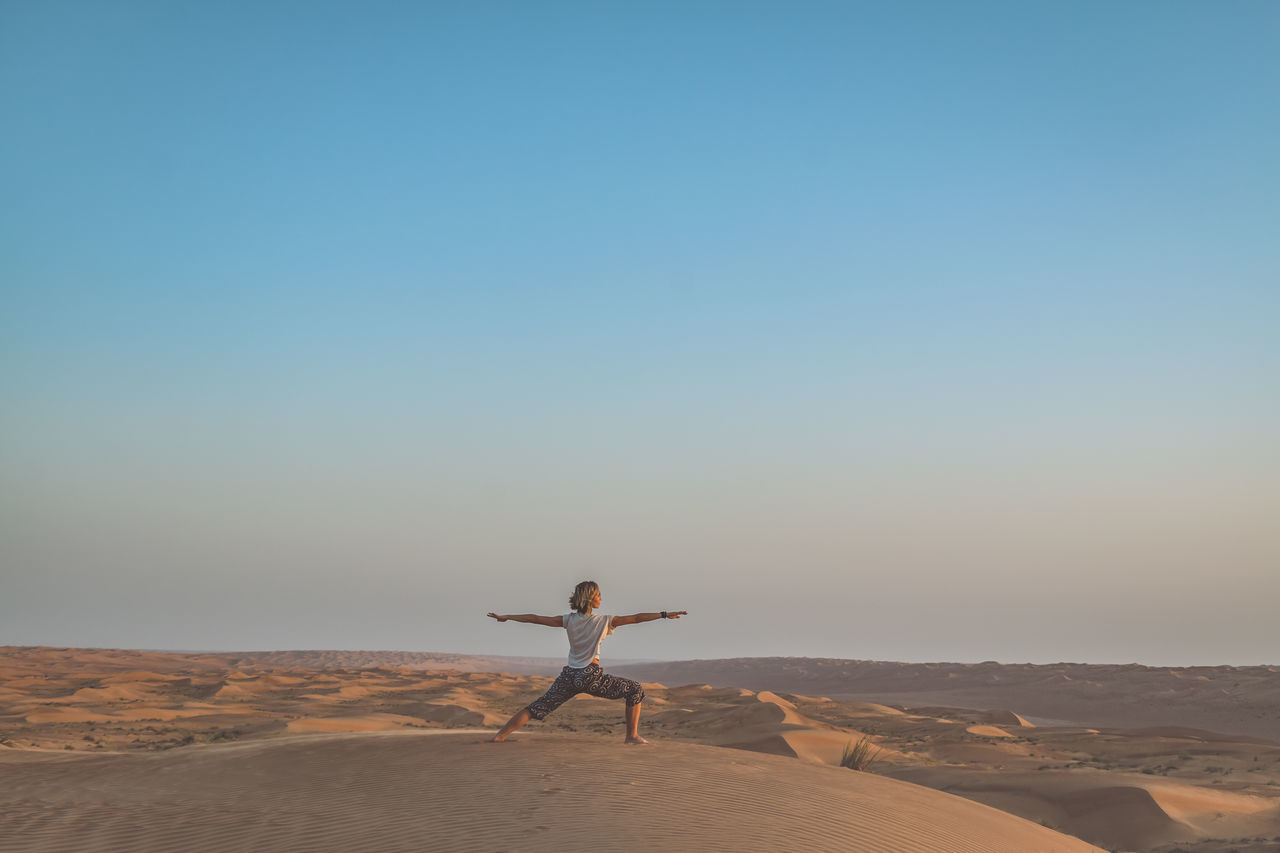 Desert Desert Lifestyles Nature Oman One Person Outdoors Sand Sand Dune Wahiba Sands Yoga Yoga Pose Young Adult Young Women Live For The Story