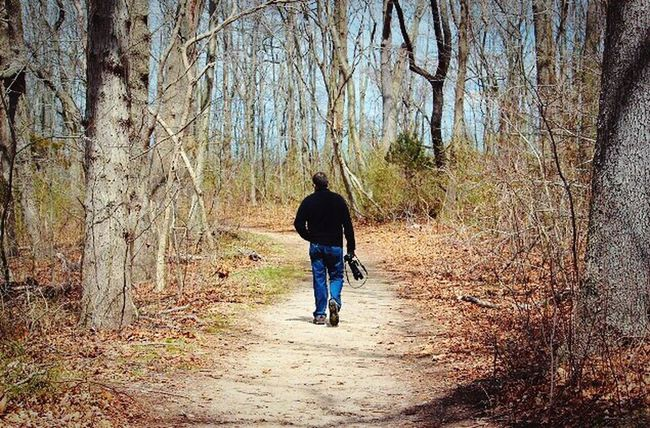 Man Walking From Behind Man Walking In The Woods Hiking