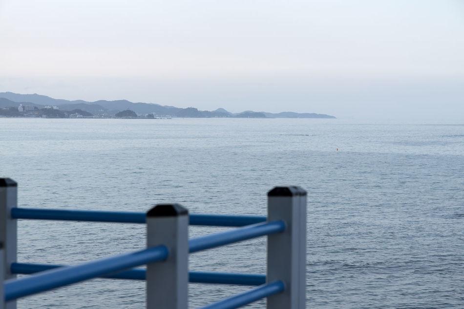 rocky coast near Jumunjin Port, Gangreung, Gangwondo, South Korea Beauty In Nature Close-up Coastline Day Fog Nature No People Observatory Outdoors Railing Rocks Scenics Sea Seaside Sky Tranquil Scene Tranquility Veranda Water