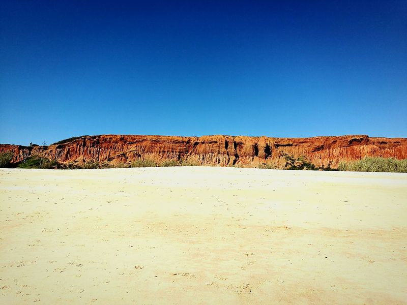Sand Blue Clear Sky No People Landscape Beach Portugal Algarve Portugal Mobilephotography Beauty In Nature HuaweiP9 Huaweiphotography IMography Cliffs Red Cliffs
