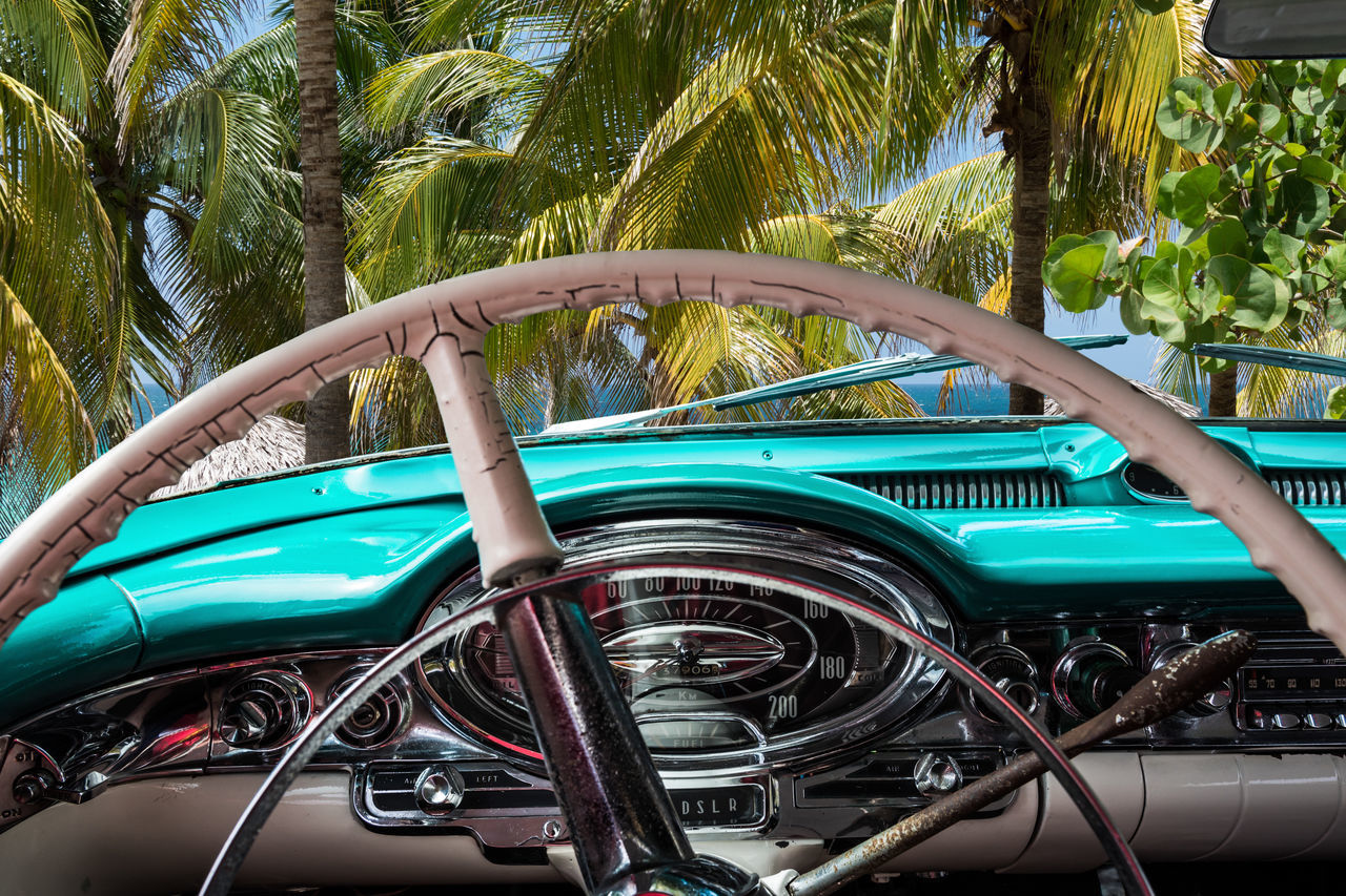 beautiful american vintage car interior view in Cienfuegos Cuba American Automobile Beach Cabriolet Classic Cockpit Colorful Colorfull Colourful Console Cuba Dashboard HDR Interior Interior Design Interior Views Oldtimer Palm Palm Tree Summer Vehicle Vintage Vintage Cars Water Wheel