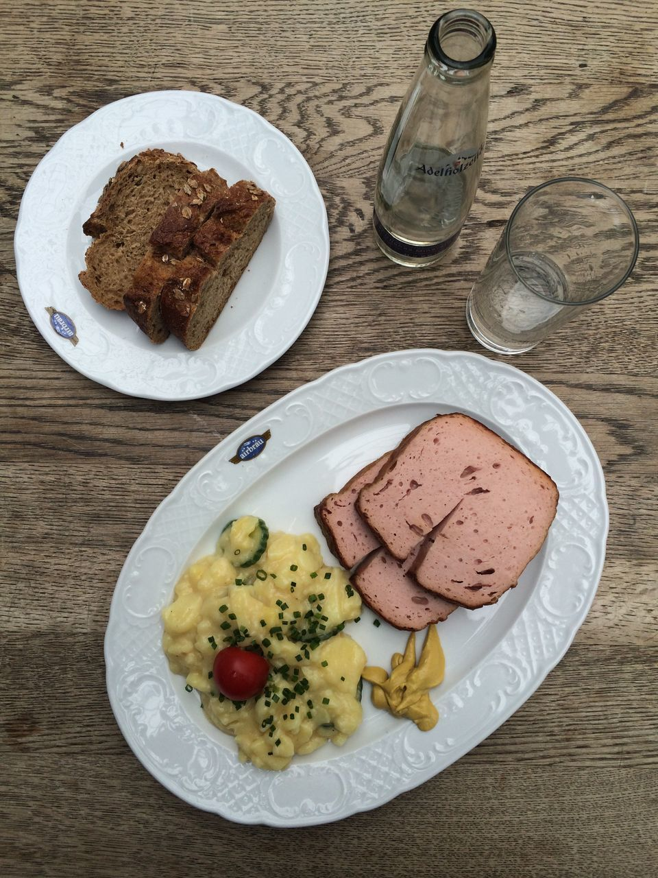 plate, food and drink, table, food, indoors, bread, high angle view, fork, ready-to-eat, meat, freshness, drinking glass, no people, drink, close-up, day