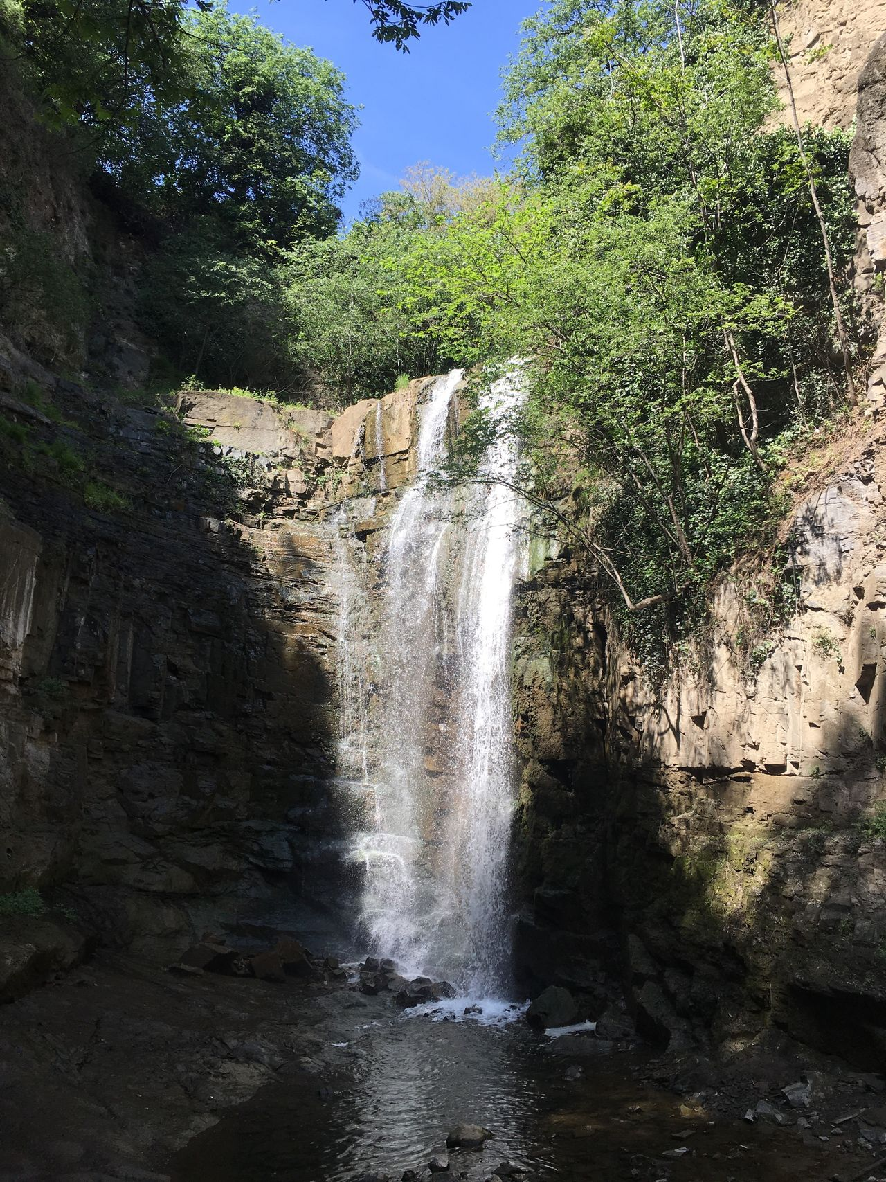 Waterfall Nature Scenics Beauty In Nature Flowing Water Rock Formation Water Rock - Object Tree No People Day Outdoors Tranquil Scene Motion Travel Destinations Cliff Sky