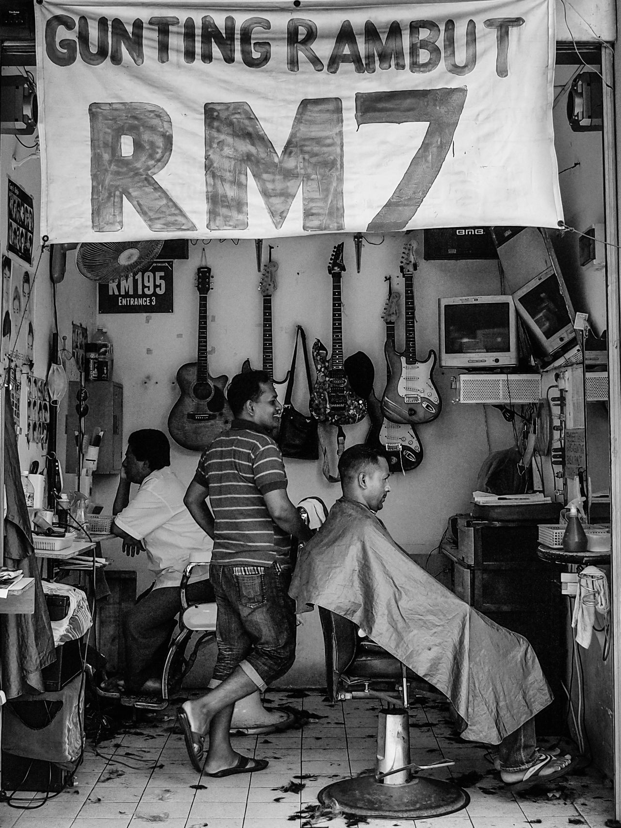 At a Barber shop Haircut Hairstyle Hairdresser Barbershop Retro Hairstyles classical Classical Barbershop Kuala Lumpur Malaysia  Chow Kit Streetphotography Street Of Malaysia Enjoying Life Man At Work Streetphoto_bw Black And White Black And White Photography Asianstreets Cheap Haircut