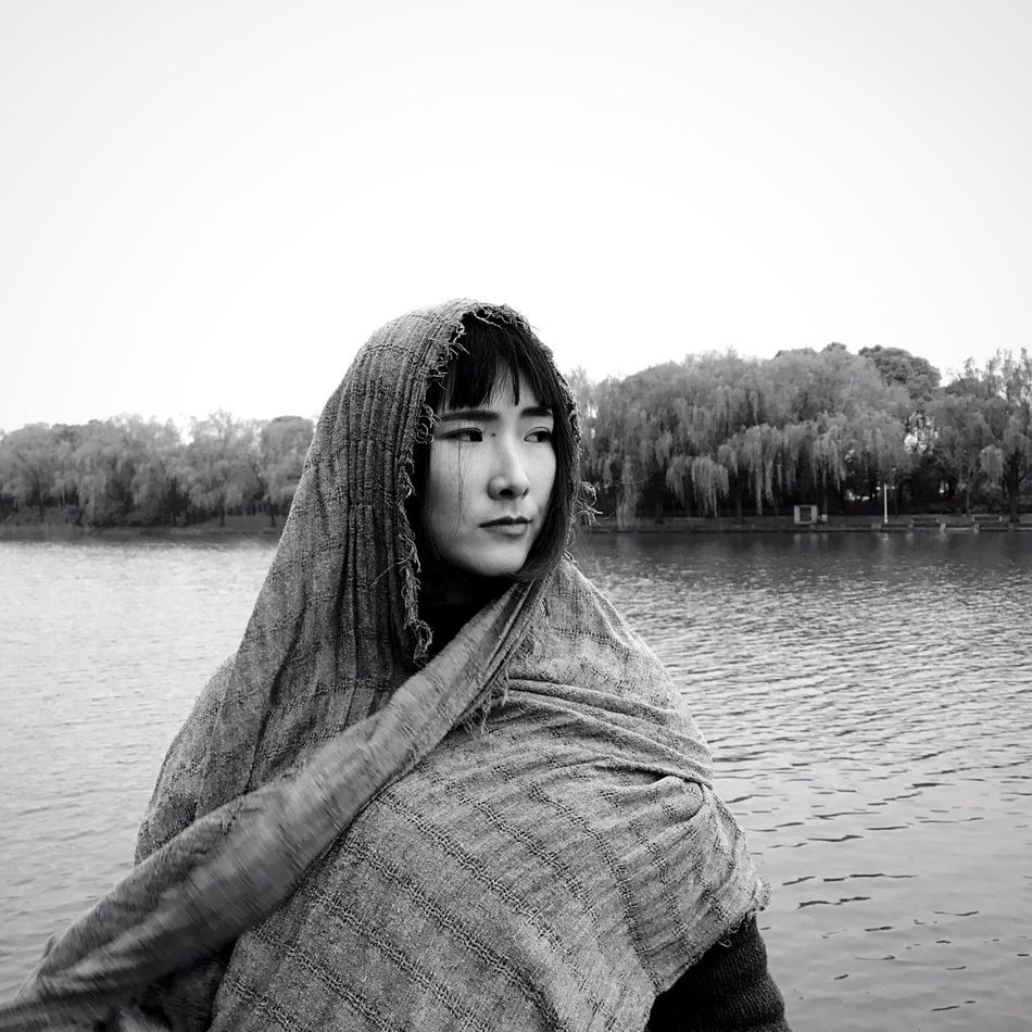 Lake One Person Water Portrait Young Adult Outdoors Looking At Camera Real People Day Front View Nature Long Hair Leisure Activity Standing Young Women Tree Clear Sky Beautiful Woman One Young Woman Only Warm Clothing Blackandwhite Photography Black & White Black And White EyeEmNewHere Break The Mold