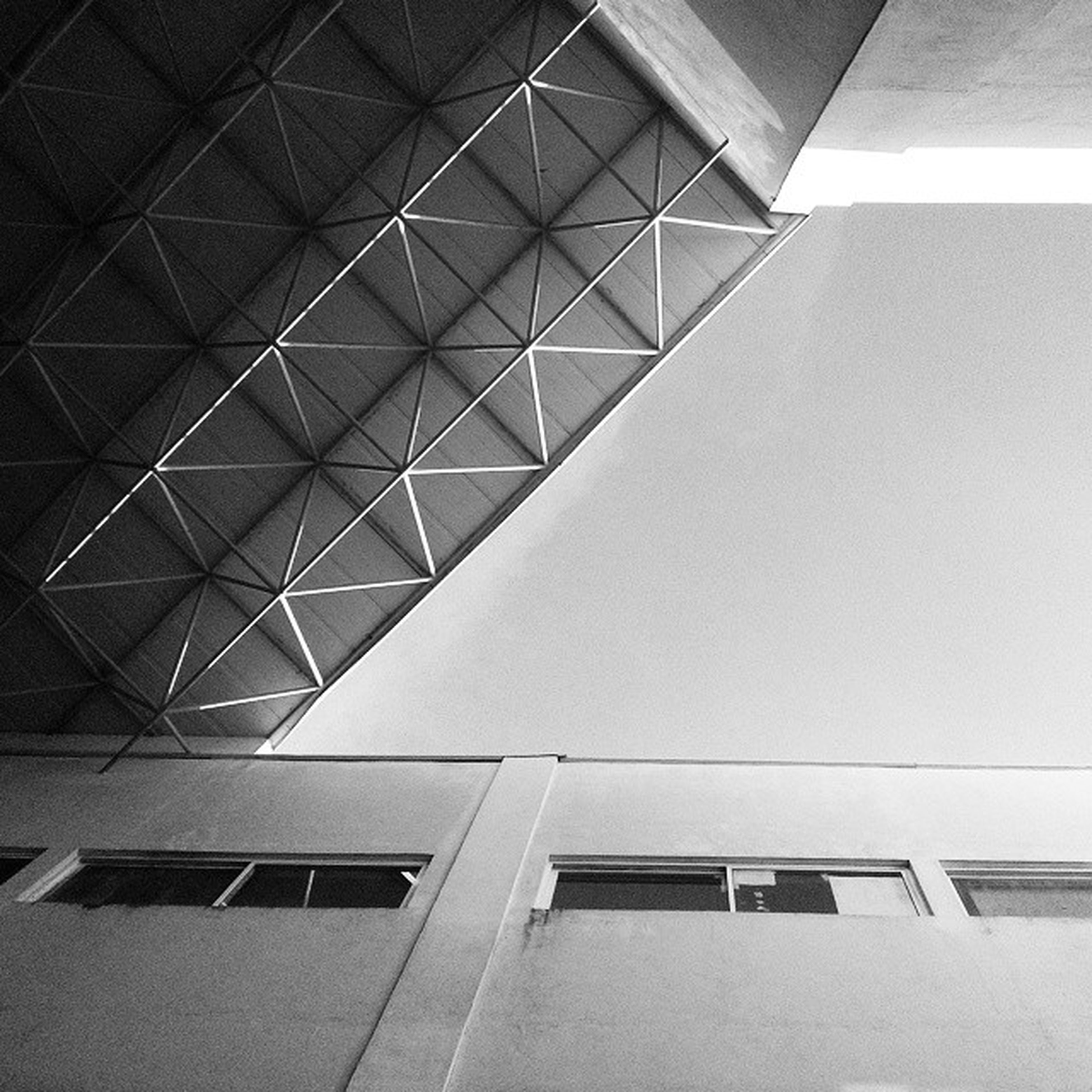 architecture, built structure, low angle view, building exterior, building, modern, window, architectural feature, city, office building, glass - material, ceiling, directly below, pattern, no people, geometric shape, day, indoors, tall - high