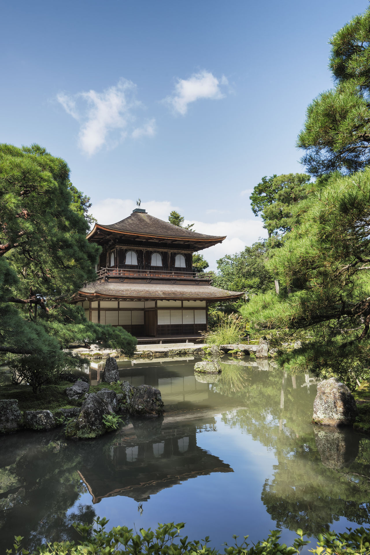 Ginkaku-ji Temple main pavilion, Kyoto, Japan Ancient City Architecture Blue Cultures Day Famous Place Ginkakuji Historical Building Japan Japanese  Kyoto Lake No People Outdoors Place Of Worship Reflection Reflection Lake Sky Temple Tranquility Travel Travel Destinations Tree Water Zen Garden