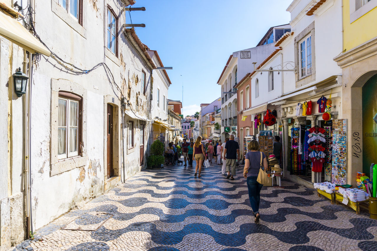 Portuguese street scene with mosaic pavement Architecture Building Exterior Built Structure Day Gift Shops Light And Shade Mosaic Outdoors Portugal Real People Shadow Sky Store Sunlight Tourism