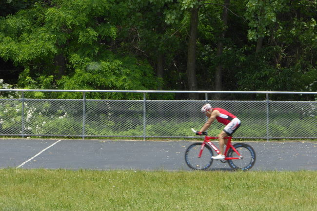 Cyclist on the velodrome. Bicycle Cycle Day Exercise Grass Green Color Mode Of Transport Modeoftransport Movingforward Outdoors Park Tranquility Tree Velodrome