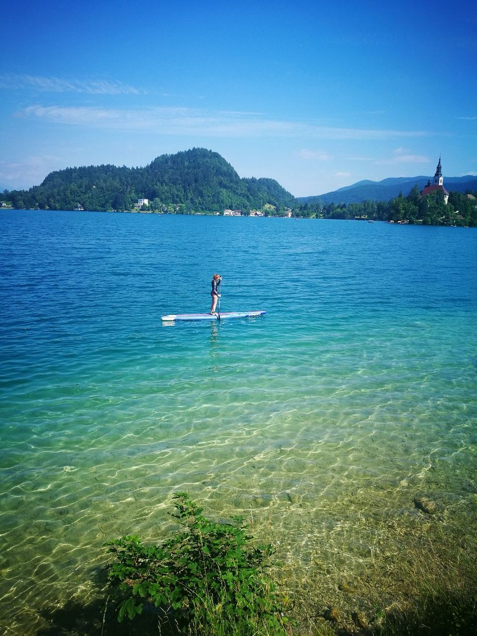 Stand up paddling at lake Bled Stand Up Paddling Sup Starboardsup Lake Bled, Slovenia Slovenija Nature Sunny Day