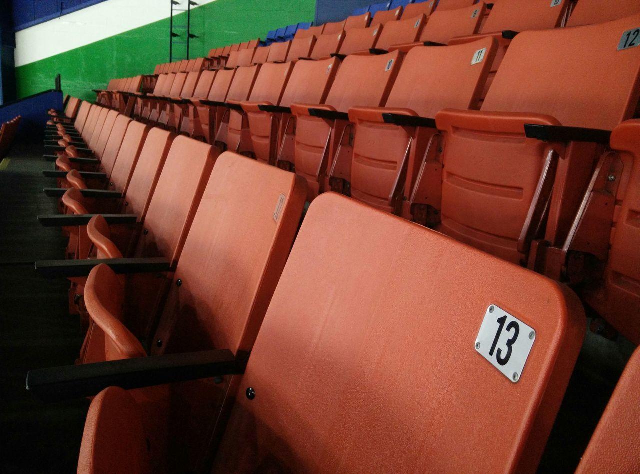 Orange Chairs Thirteen Auditorium Sports