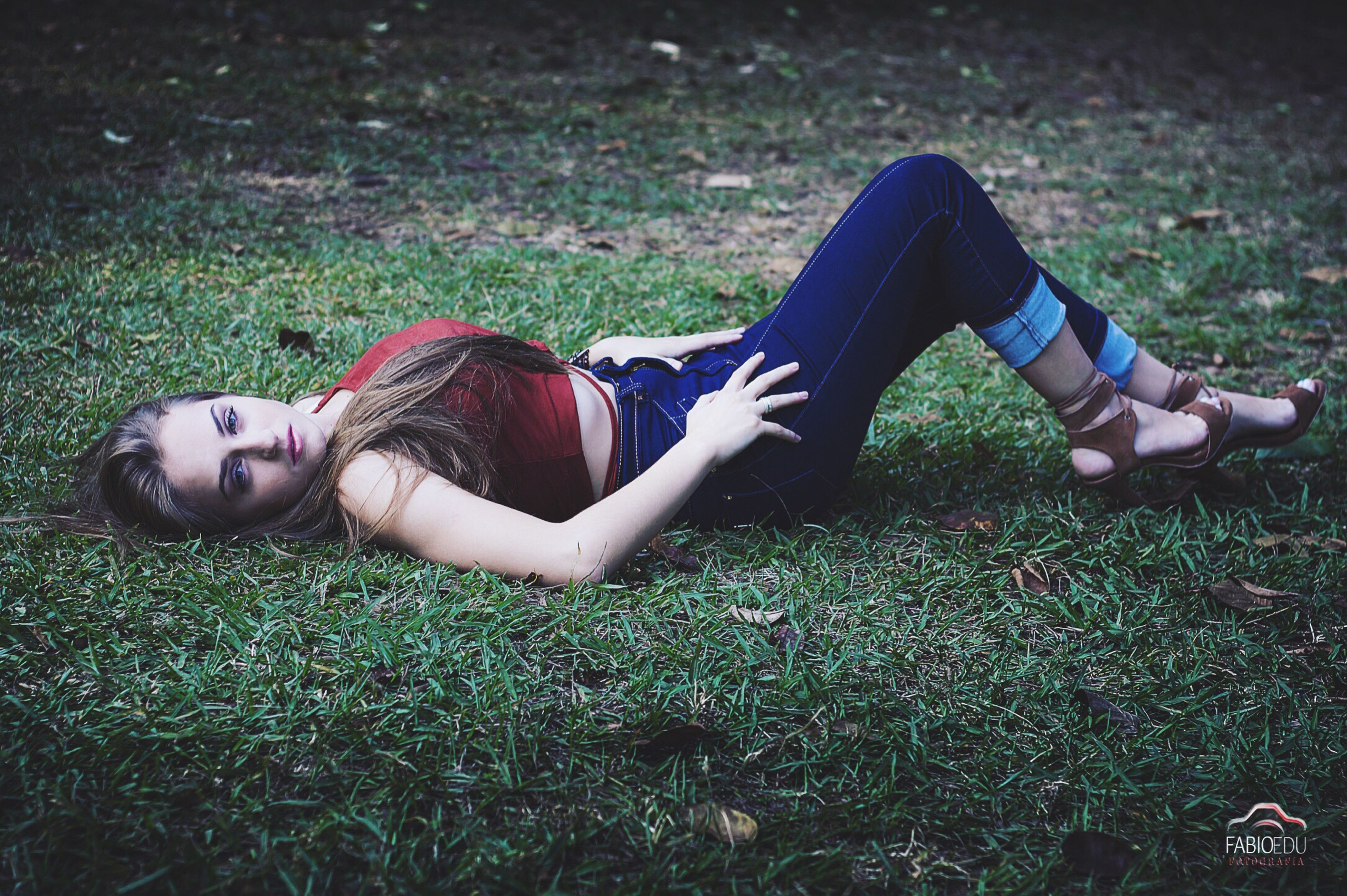 grass, low section, person, lifestyles, shoe, grassy, relaxation, leisure activity, field, lying down, sitting, resting, footwear, relaxing, high angle view, casual clothing, young women, human foot