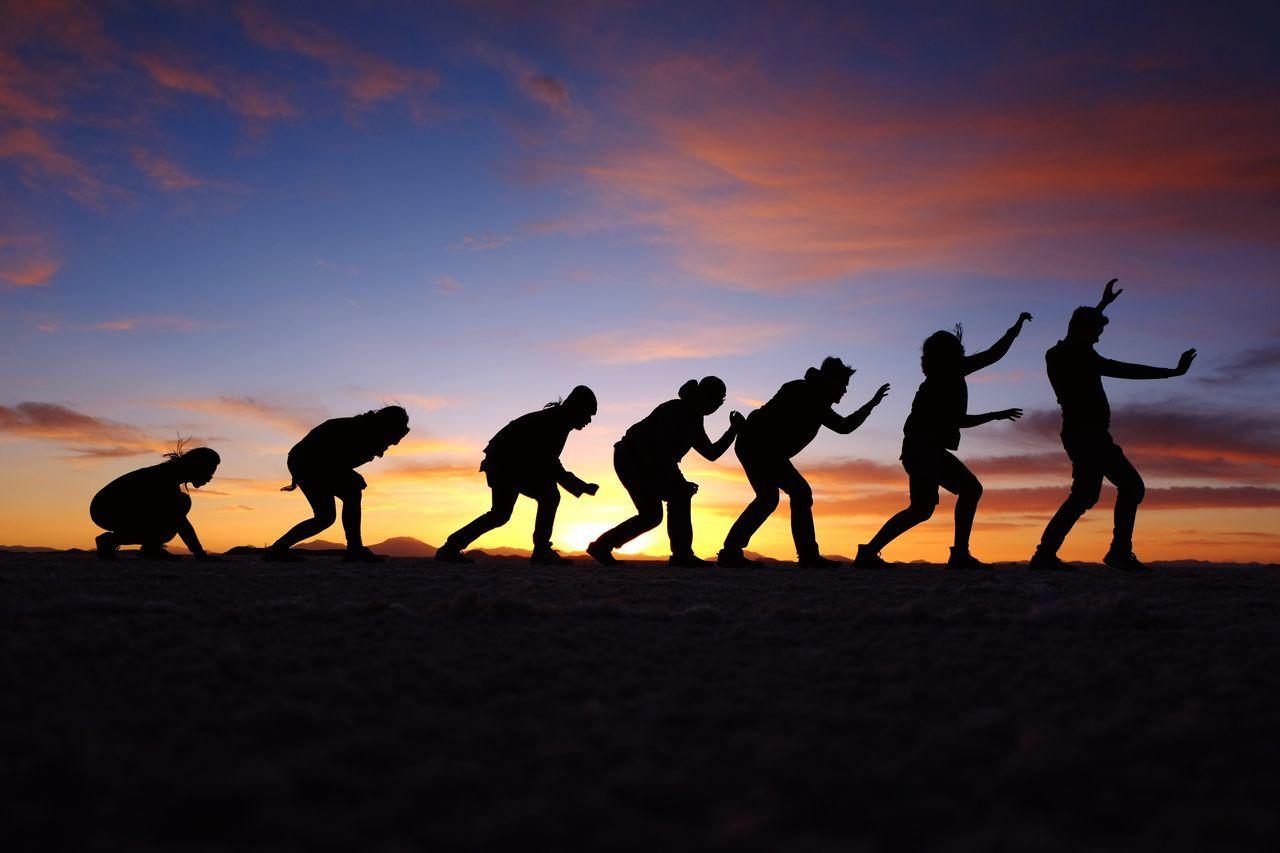 Evolution. Sunset Sunset Sillhouettes Evolution Of Man Travel Friendship Salar De Uyuni Group Shot Friends Playing Fun Bolivia